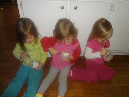 The triplets eating yogurt